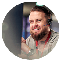 Man smiling while on headset