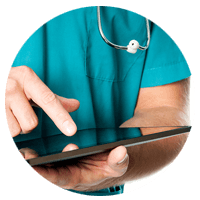 Healthcare nurse using tablet computer to review patients secure information