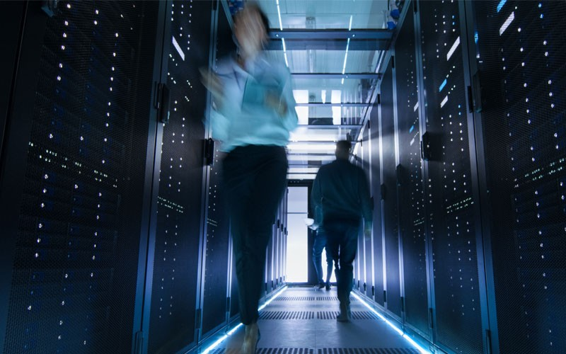 Two people walking through data center security
