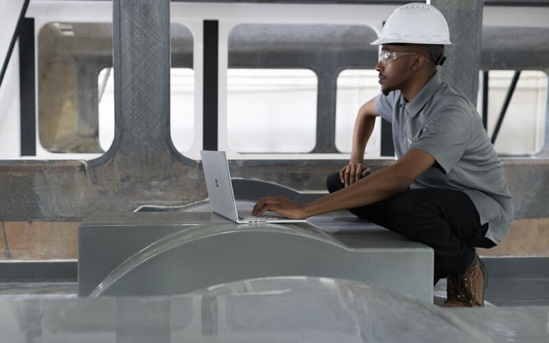Engineer working on Microsoft Surface in the field