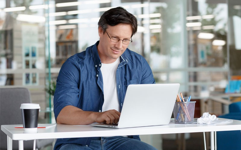 Business man using laptop at desk