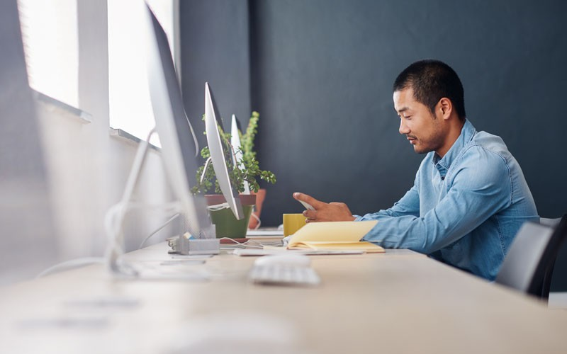 Employee sitting at desktop