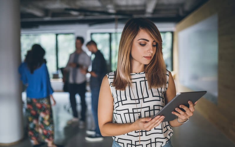 Woman holding tablet in office