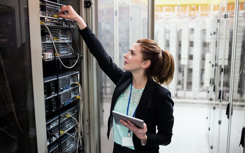Woman looking in data center