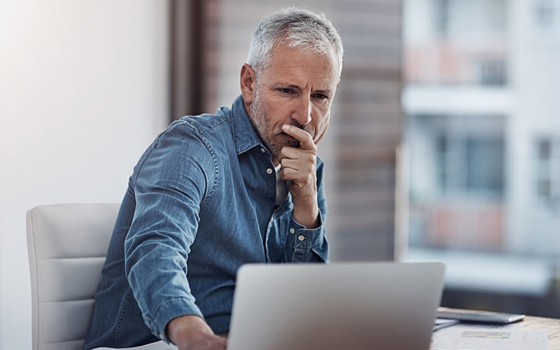 Businessman looking at laptop