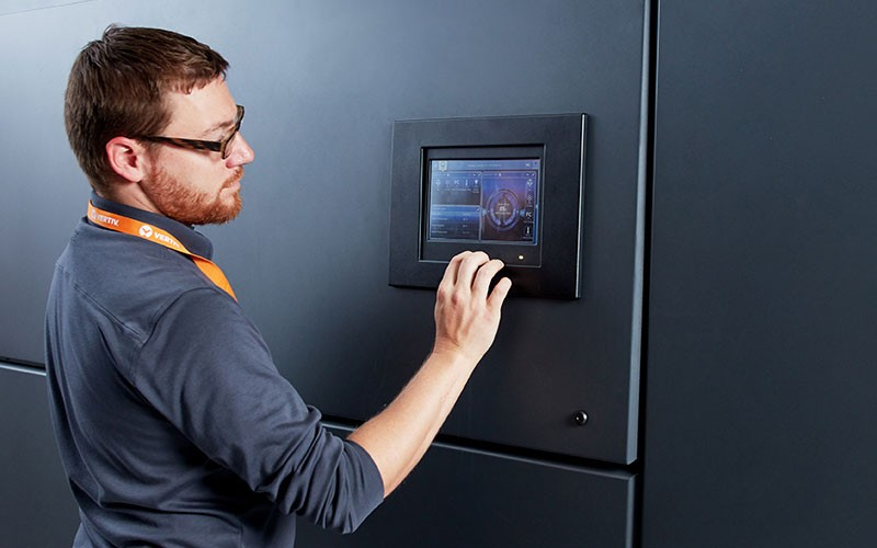Vertiv employee touching IT system touch screen